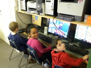 Kindergarten students learning on computers